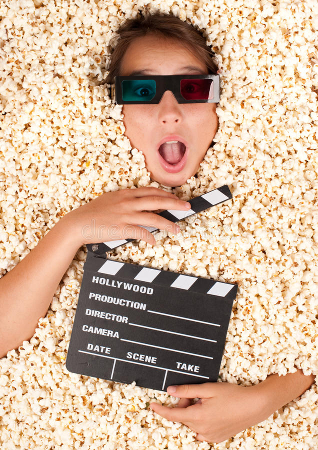 Download Young Girl Buried In Popcorn Stock Photo - Image of motion, background: 26576566