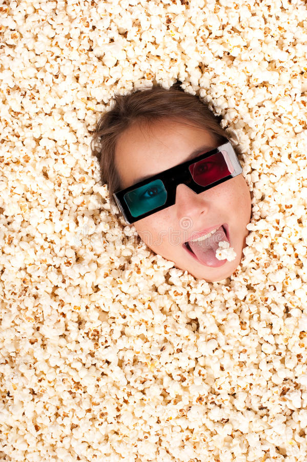 Download Young Girl Buried In Popcorn Stock Image - Image of happy, film: 26576593