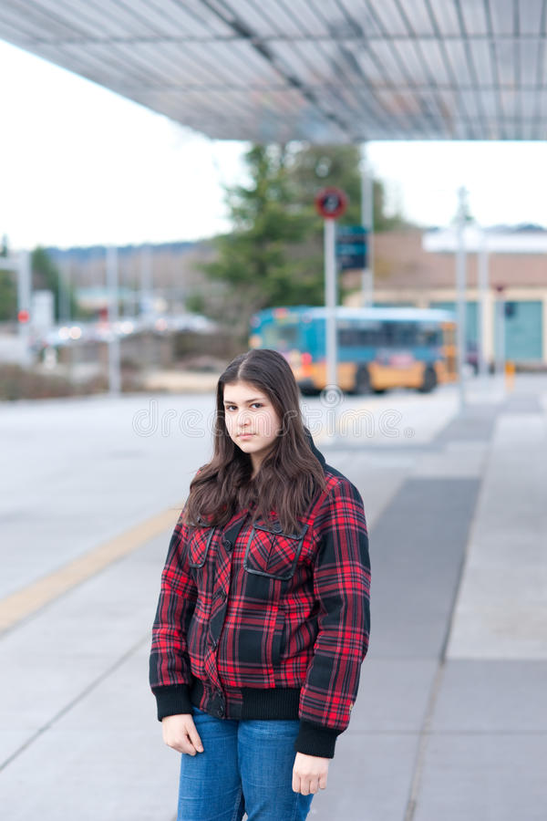 Download Young girl on bus stop stock photo. Image of beauty, plaid - 12970800