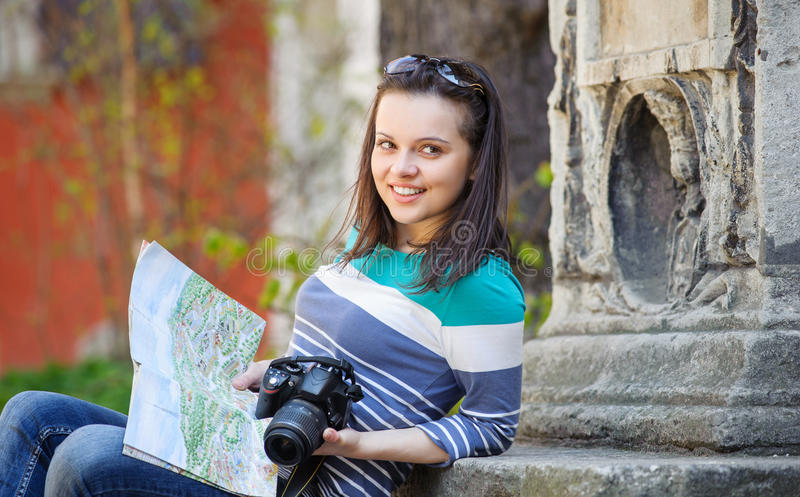 Young girl with a camera and map royalty free stock image