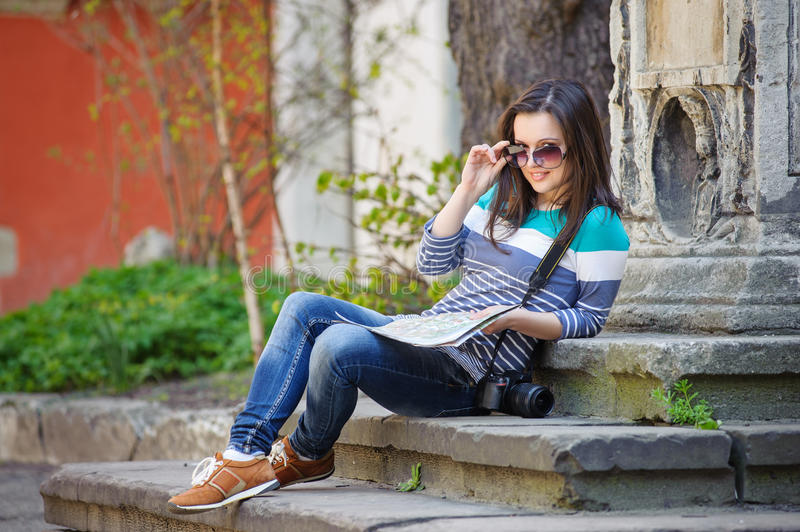Young girl with a camera and map stock photos