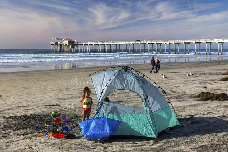 Young Girl Camping on La Jolla Shores Beach north of San Diego California stock photography