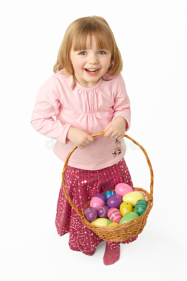 Download Young Girl Carrying Basket Filled With Easter Eggs Stock Photo - Image: 12988016