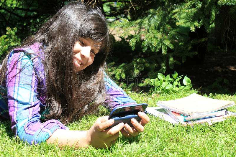 Download Young girl  with cellphone stock image. Image of outdoors - 25868145