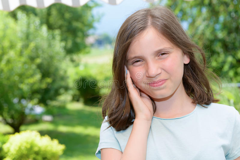 Young girl child an earache, outdoor royalty free stock images
