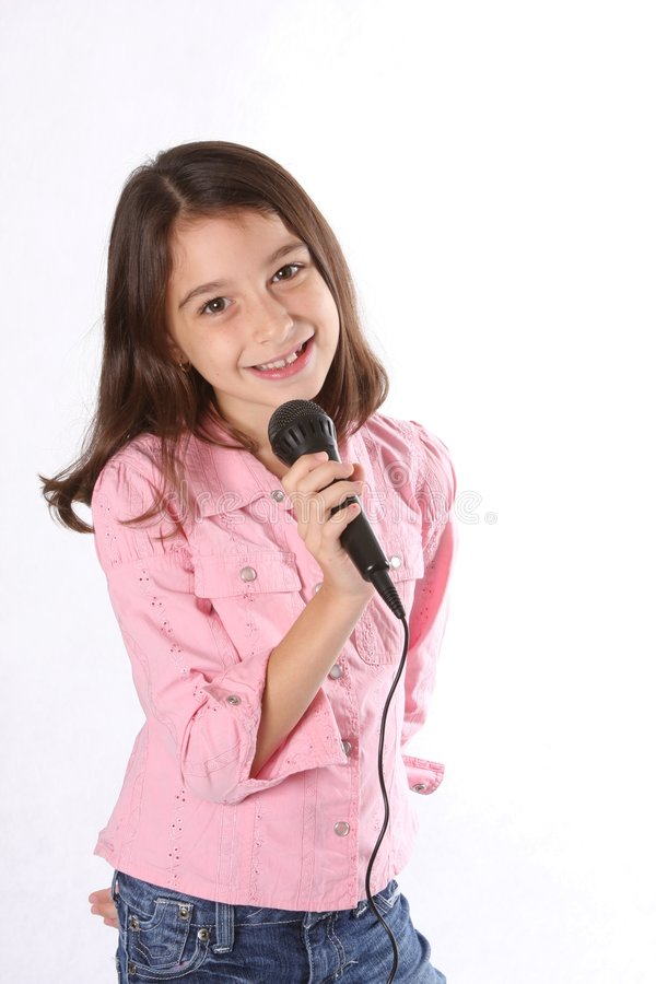 Young Girl / Child Singing With Microphone Royalty Free Stock Photo