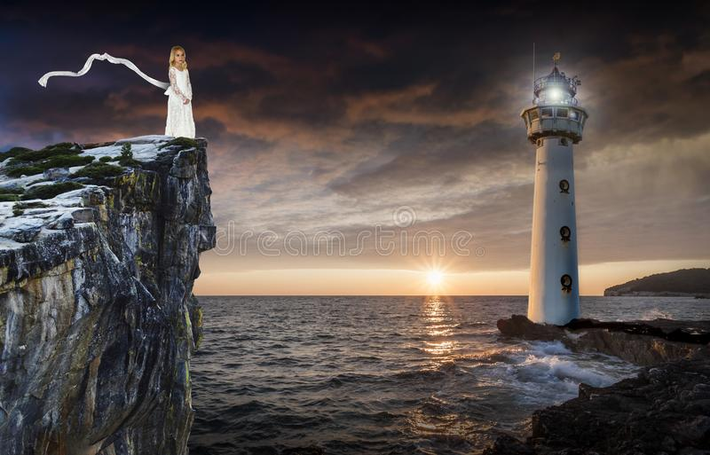 Fantasy Dream, Lighthouse, Sea, Ocean. A young girl child stands on a cliff in a dream fantasy landscape. Lighthouse overlooks the sea or ocean. Abstract concept royalty free stock images