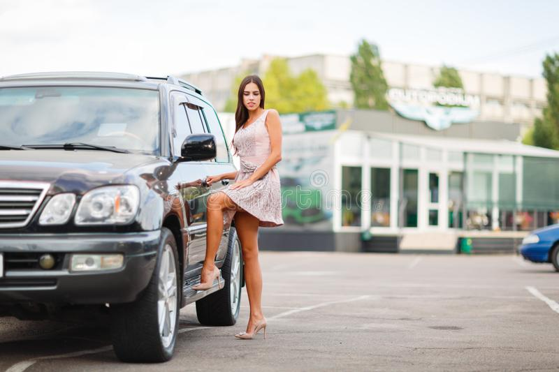 Download Young Girl Chooses A Used Car In Parking Lot Buying New