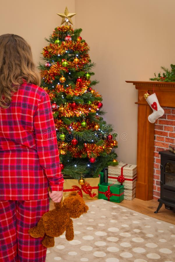 Young girl on Christmas morning. stock photography