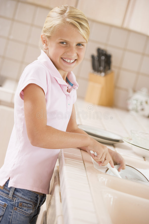 Download Young Girl Cleaning Dishes stock photo. Image of camera - 6882280