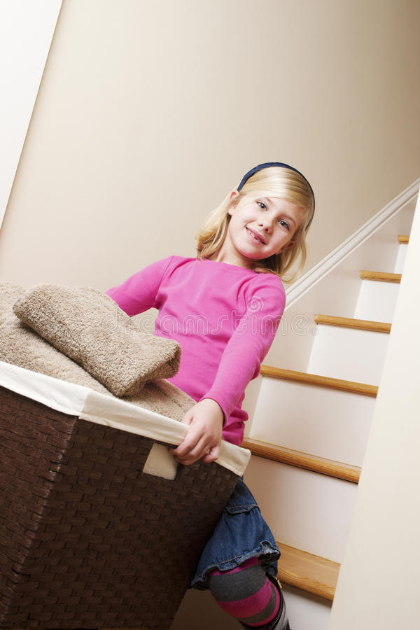 Download Young Girl Cleaning Laundry Stock Photo - Image: 18546594