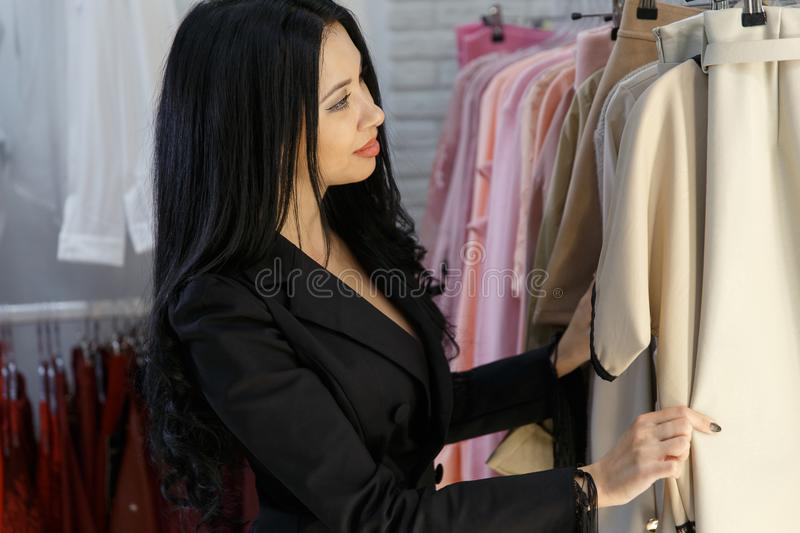 Young girl in clothing store stock images