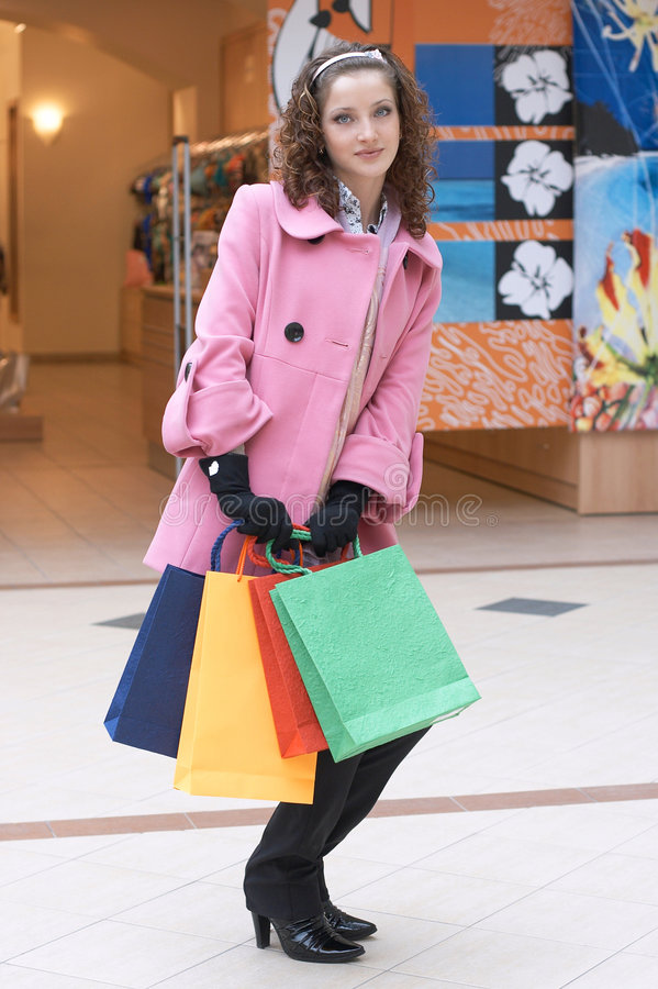 Young girl with colored bags royalty free stock image