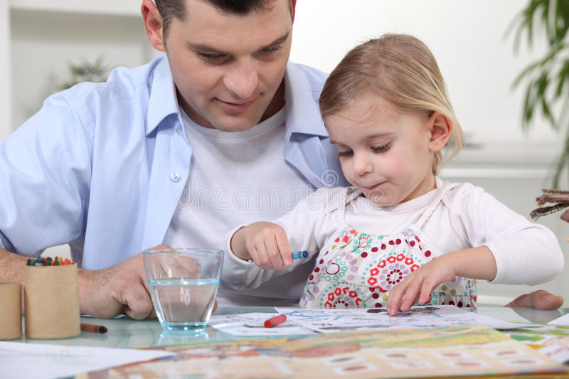 Young girl coloring in stock image