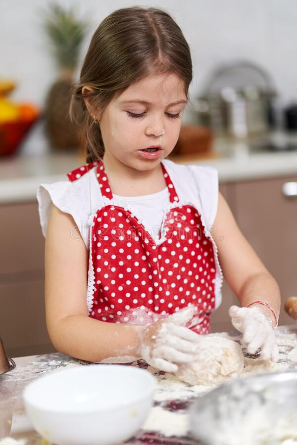 Young girl cooking a pastry royalty free stock images
