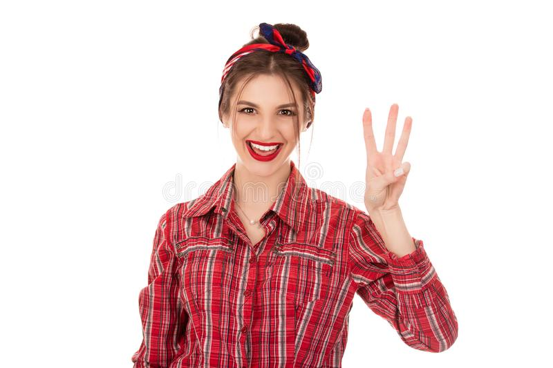 Young girl counting three with fingers. Closeup cutout portrait of a beautiful woman girl wearing red checkered buttoned shirt isolated on a pure white royalty free stock images