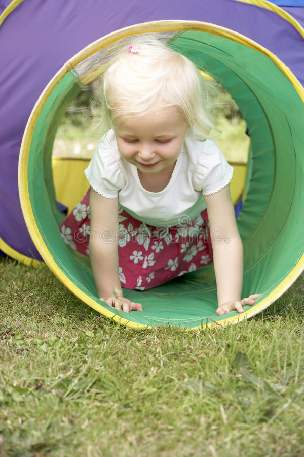 Young Girl Crawling Through Play Equipment Royalty Free Stock Image