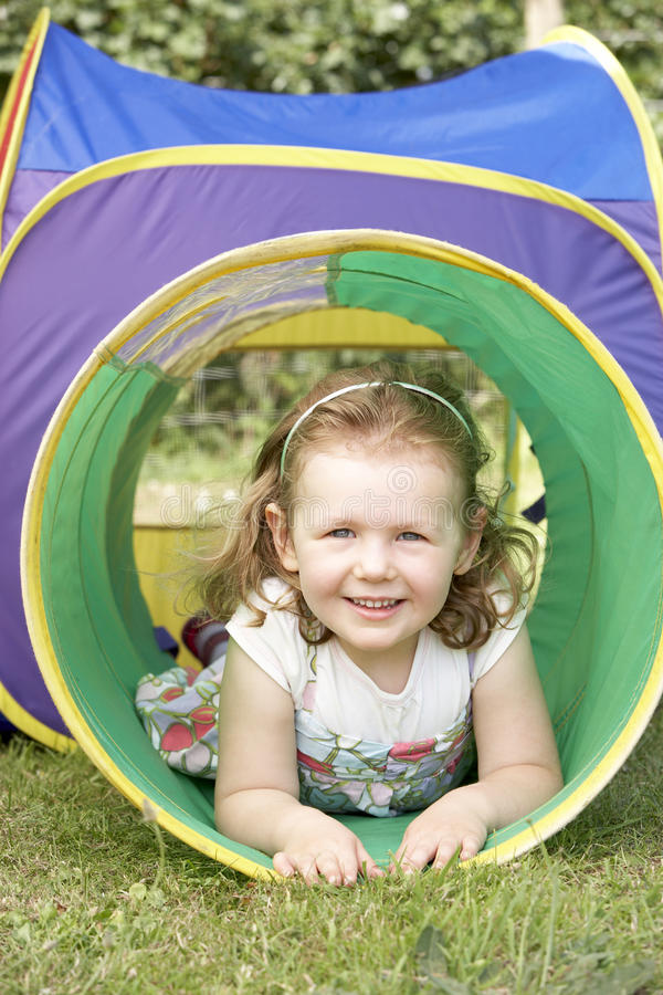 Download Young Girl Crawling Through Play Equipment Stock Image - Image: 10971731