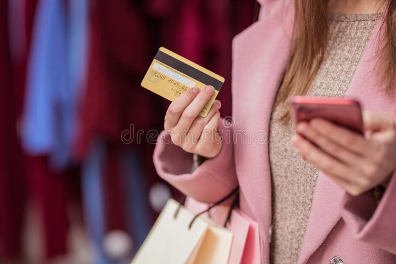 Young girl with a credit card stock photos