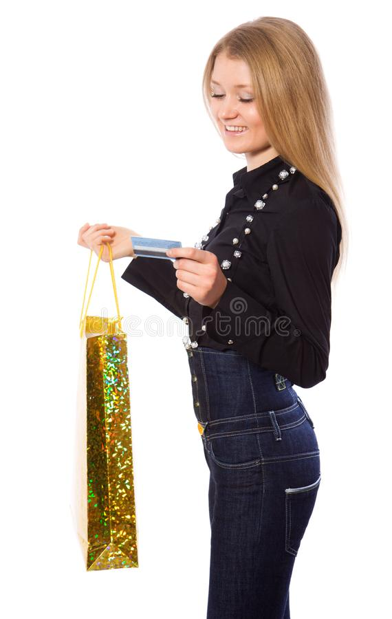 Young girl with credit card and shopping bag stock image