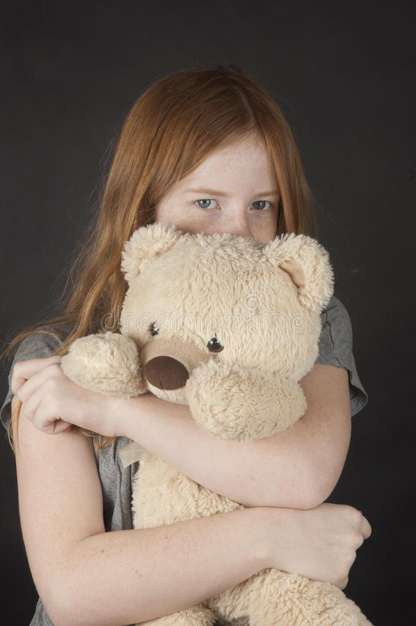Download Young Girl Is Cuddling With A Teddybear Stock Photo - Image of love, children: 18554090