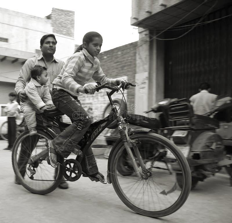 Free Young Girl Cycling In Neighbourhood Stock Photo - 4344830