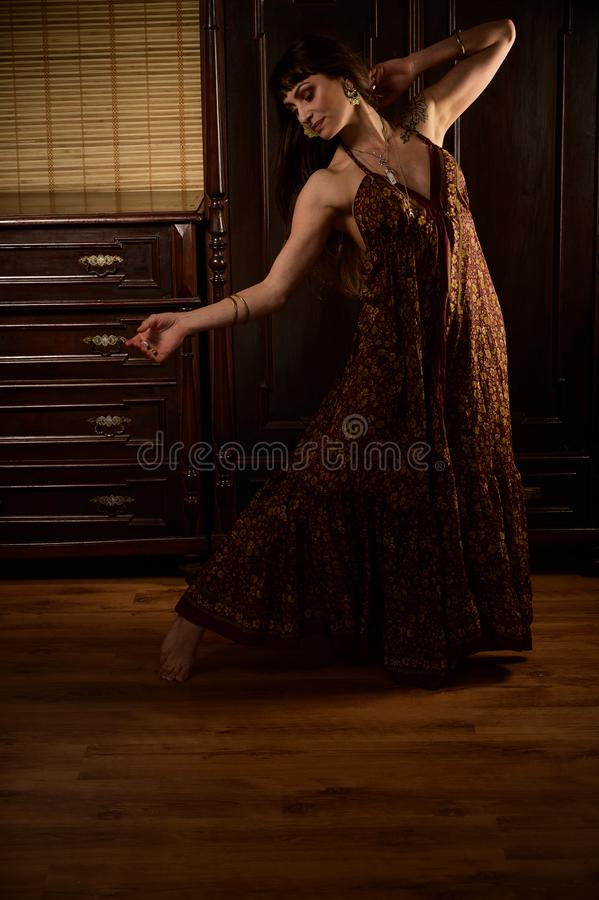 Young girl dancer and singer in gypsy dress dancing and posing on stage.  royalty free stock images