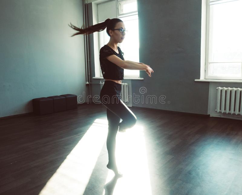 Young girl dancing contemp. Dynamic shot in the jump. stock image