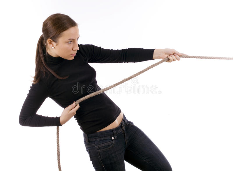 Download Young Girl In Dark Clothes Pulling Grey Rope Stock Photos - Image: 12705903