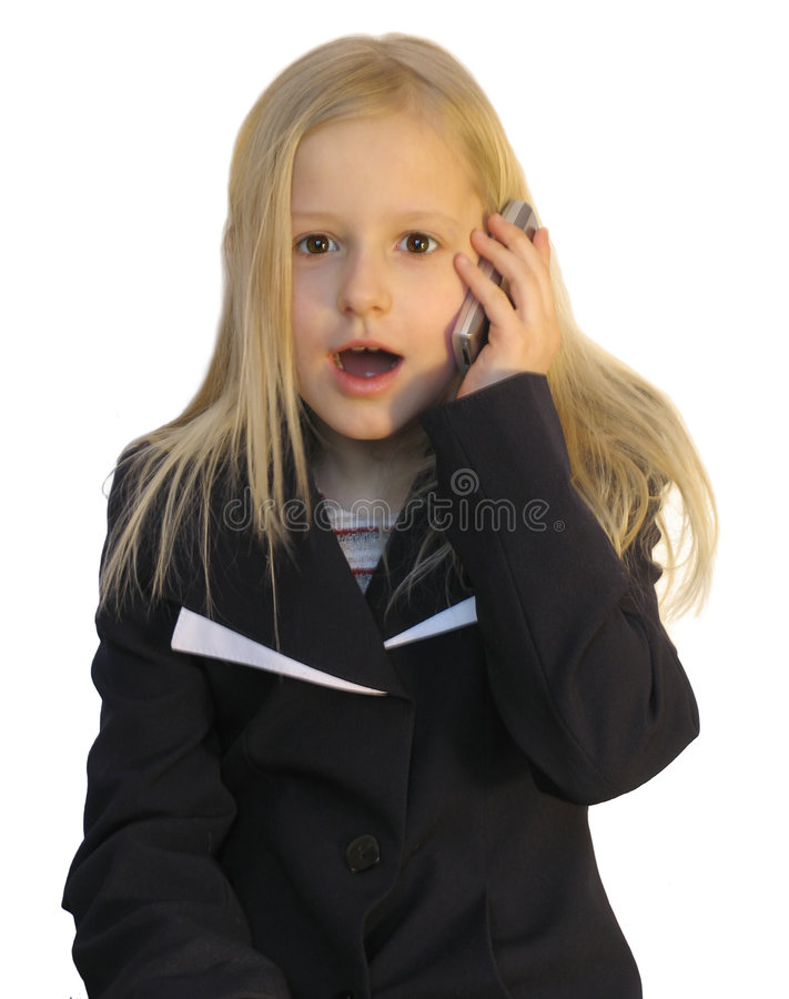 Young girl dialing phone number stock photo
