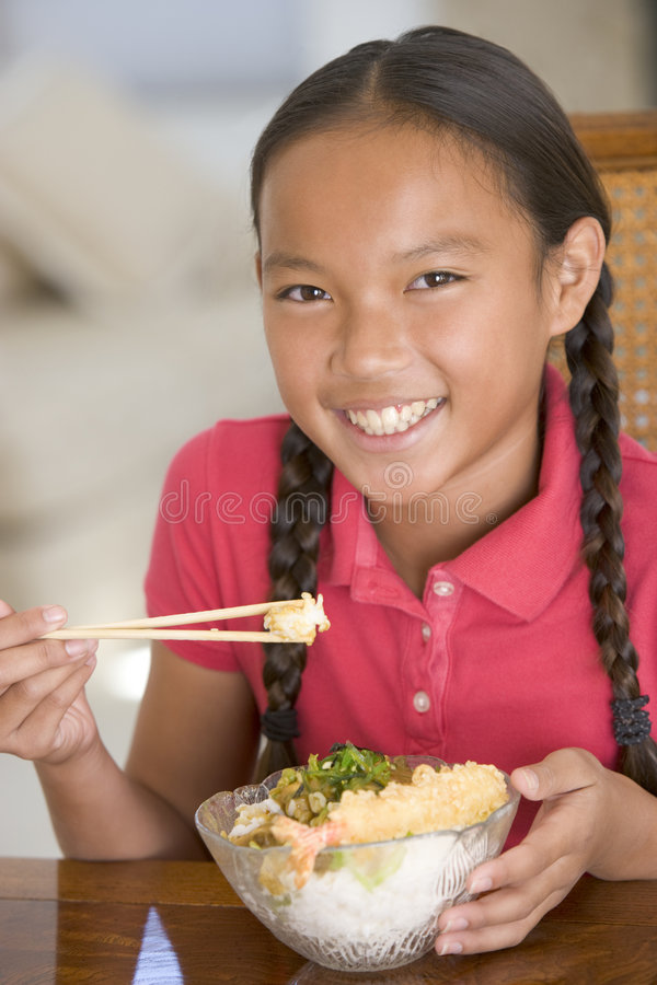 Download Young Girl In Dining Room Eating Chinese Food Stock Image - Image: 5938707