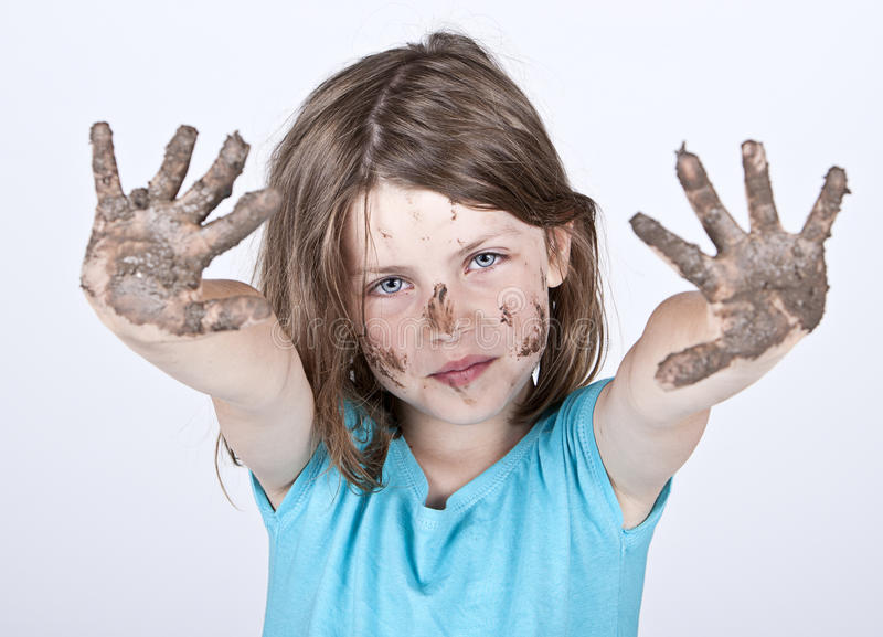Young Girl with Dirty Hands and Face royalty free stock image
