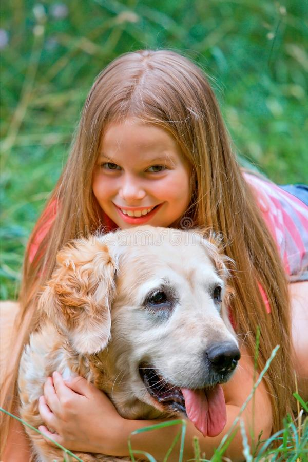 Download Young girl and dog stock photo. Image of golden, friend - 10502690