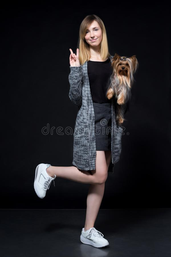 Young girl with dog in arms stock photos