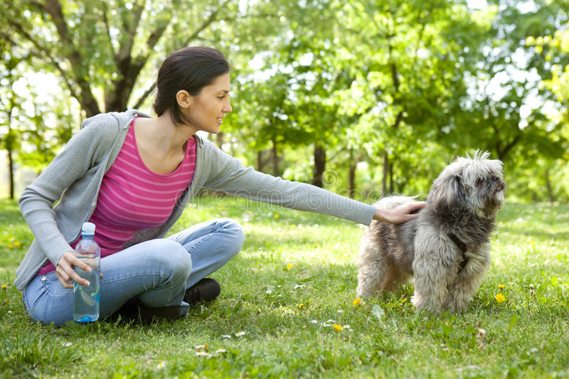 Download Young Girl With A Dog In The Park Stock Photo - Image of cheerful, smiling: 19693360