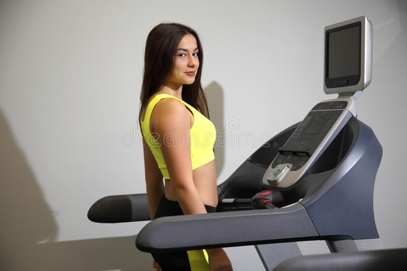 Young girl doing fitness exercises in the gym. royalty free stock photography