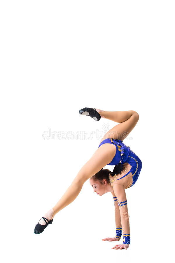 Young girl doing gymnastic exercises isolated. The girl in a blue dancing suit stock photos