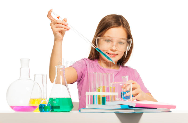Young girl doing her chemical test in laboratory royalty free stock photos
