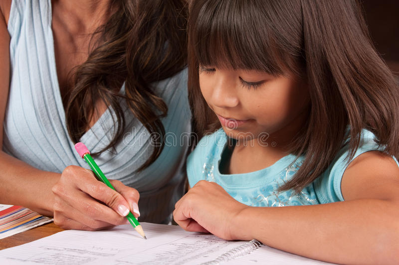 Young girl doing homework stock images