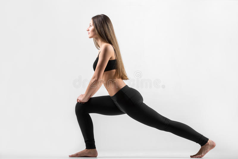 Young girl doing lunge exercise stock photography