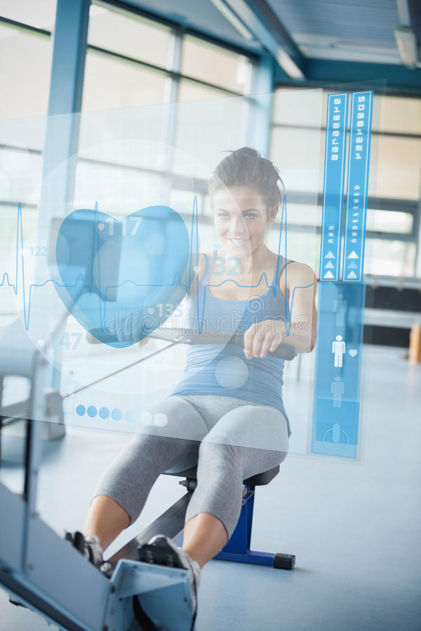 Young girl doing rowing machine with futuristic interface. Young smiling girl doing rowing machine with futuristic interface royalty free illustration