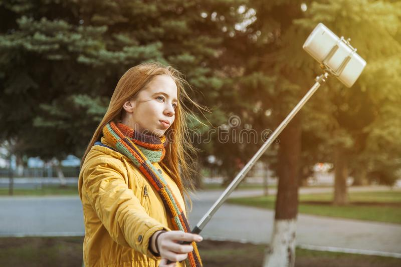 Young girl doing selfie on nature on a sunny day stock photo