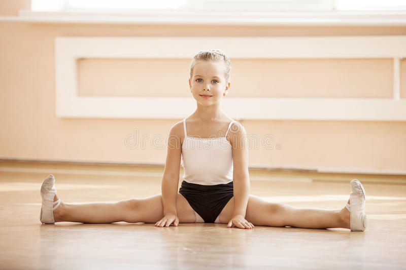 Young girl doing splits while warming up royalty free stock photos