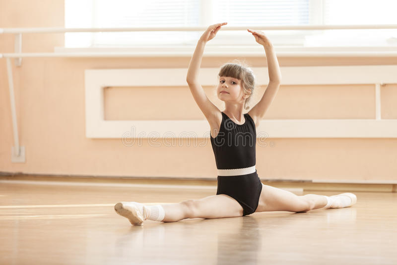 Young girl doing splits while warming up royalty free stock images