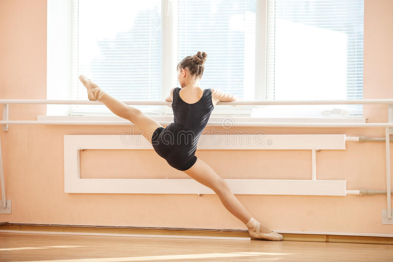 Young girl doing splits while warming up stock image