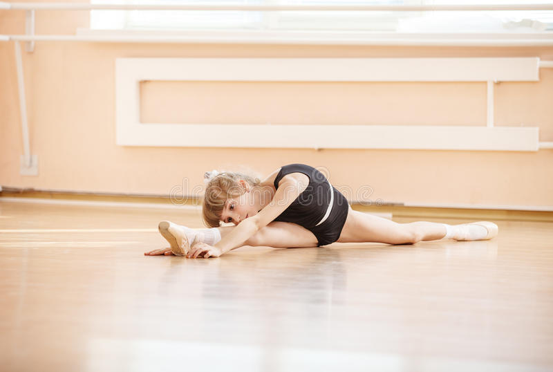 Young girl doing splits while warming up stock photos