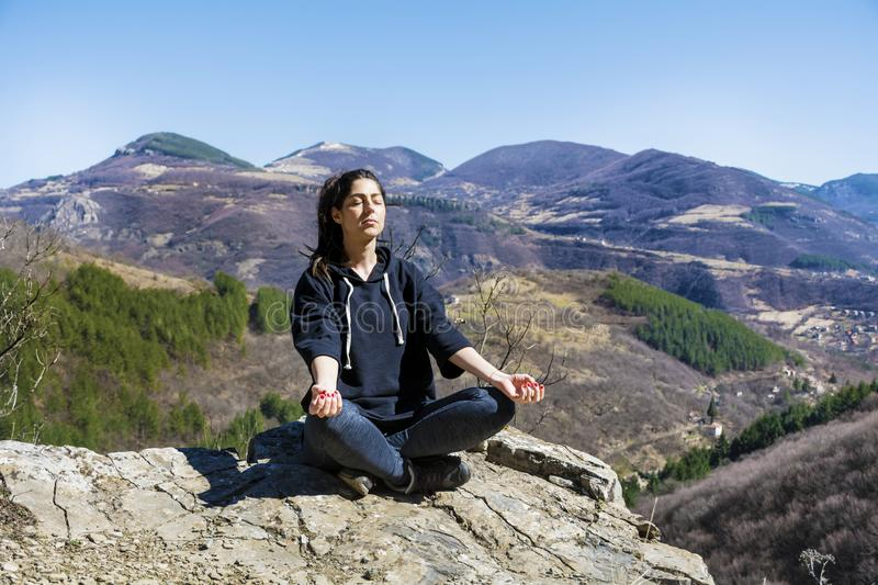 Yoga Woman Meditating in the Mountain stock images