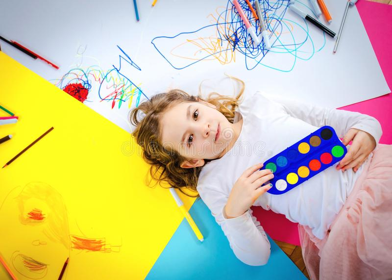Young girl draw and play with colorful crayons. stock photos