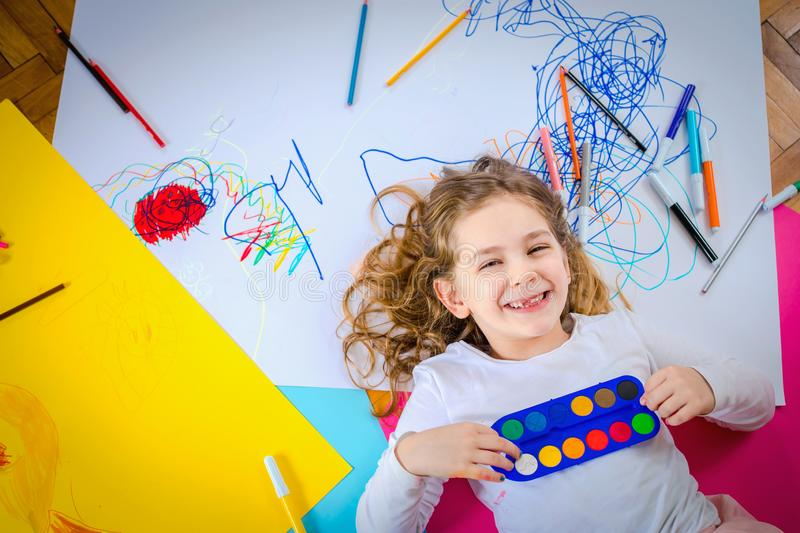 Young girl draw and play with colorful crayons. stock illustration