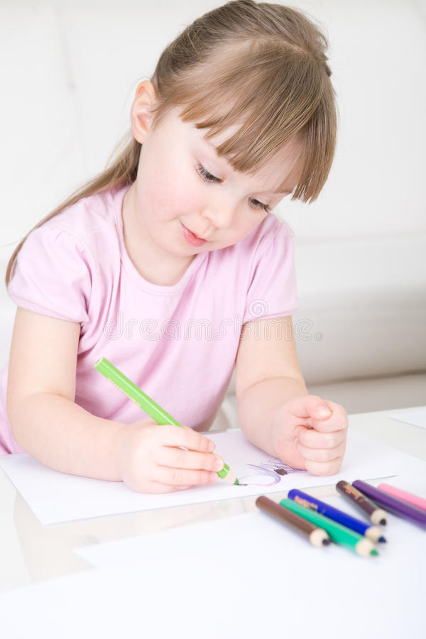 Young girl drawing stock photo